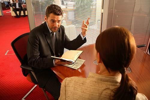 man-woman-talking-office